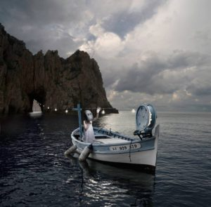 Alastair Magnaldo: Girl on a Boat Wearing a Mask